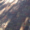 poorly sealed paver patio in need of restoration