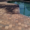 Paver pool deck sealed with SealNLock super wet sealer